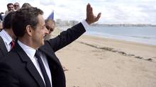 French President Nicolas Sarkozy waves to supporters as he strolls along the seafront after his last campaign meeting in Les Sables-d'Olonne, western France on Friday, May 4, two days ahead of the second round of the French presidential elections. (Eric Feferberg/Eric Feferberg/AP)