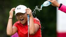 Fifteen-year-old Lydia Ko, of New Zealand won the CN Canadian Women's Open LPGA golf tournament at the Vancouver Golf Club in 2012. (DARRYL DYCK/THE CANADIAN PRESS)