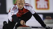 Team Canada skip Pat Simmons delivers a rock as he plays Northern Ontario during gold medal game curling action at the Brier in Calgary on Sunday, March 8, 2015. (Jeff McIntosh/THE CANADIAN PRESS)