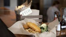 Fish and chips are served with fresh-cut Kennebec fries and house-made cabbage-and-kale coleslaw. (Rafal Gerszak For the Globe and Mail)