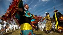 A member of the Assembly of First Nations dances at Fort York in Toronto last summer at the start of a memorial service commemorating first nations warriors who fought in the War of 1812. (Galit Rodan/The Globe and Mail)