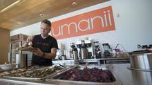 Chef Andrew Muto, serving up healthy fare at his restaurant inside Vaughan City Hall, steers people clear of overprocessed junk food. (J.P. Moczulski for The Globe And Mail)