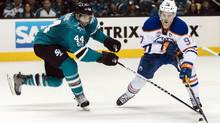 Edmonton Oilers centre Connor McDavid vies for the puck with San Jose Sharks defenceman Marc-Édouard Vlasic during Game 3 of their playoff series on April 16, 2017, in San Jose. (John Hefti/USA Today Sports)