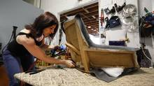 Upholsterer Tina Morgan recovers a 1960s Finn Juhl chair in her studio in Toronto on May 31, 2012. (Deborah Baic/The Globe and Mail)