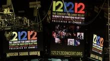 "Signage for the ""12-12-12"" concert is displayed on the Madison Square Garden jumbotron, Tuesday, Dec. 11, 2012, in New York. The Dec. 12 concert, whose proceeds will aid victims of Superstorm Sandy, will feature artists Bon Jovi, Eric Clapton, Dave Grohl, Billy Joel, Alicia Keys, Chris Martin, The Rolling Stones, Bruce Springsteen & the E Street Band, Eddie Vedder, Roger Waters, Kanye West, The Who and Paul McCartney. (John Minchillo/AP)"