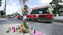 A make-shift memorial marks the location where Sammy Yatim was shot by police in Toronto, Ontario Tuesday, July 30, 2013. (Kevin Van Paassen/The Globe and Mail)