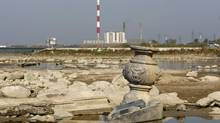 Low water levels exposed artifacts in the Vistula river bed in Warsaw on Tuesday. (KACPER PEMPEL/REUTERS)