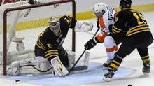 Buffalo Sabres' goaltender Ryan Miller (30) makes a save on a shot by Philadelphia Flyers center Maxime Talbot (26) as Buffalo Sabres' center Cody Hodgson (19) closes during the third period of the season opener NHL hockey game in Buffalo, N.Y., Sunday, Jan. 20, 2013. (Gary Wiepert/AP)
