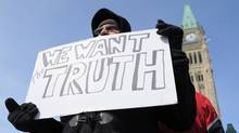 A protester decries alleged voter suppression during the 2011 federal election at a small gathering on Parliament Hill on March 5, 2012. (Sean Kilpatrick/Sean Kilpatrick/The Canadian Press)