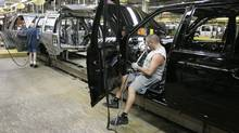 Assemblyman Brian Mullins works on a Ford Expedition at the auto maker's Michigan Truck plant in Wayne, Mich. (Carlos Osorio/AP)