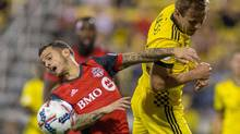 Columbus Crew SC defender Nicolai Naess heads the ball past Toronto FC forward Sebastian Giovinco in the first half of the match at MAPFRE Stadium on Saturday, April 15, 2017. Columbus Crew SC beat Toronto FC 2-1. (Trevor Ruszkowski/USA Today Sports)
