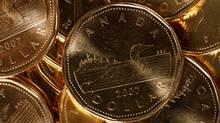 Canadian dollar coins. (Larry MacDougal)