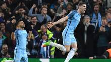 Manchester City's John Stones celebrates his goal during Tuesday's matchup against Monaco in Manchester, England. (PAUL ELLIS/AFP/Getty Images)