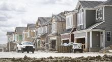 New housing construction in Calgary, Alberta is seen on Thursday, June 26, 2014. Calgary's tight housing inventory is starting to ease as more properties hit the market. (Jeff McIntosh/The Globe and Mail)