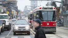 Pedestrians, cars and streetcars are seen on St. Clair Ave. between Bathurst and Dufferin in Toronto, Ont. Feb. 9/2012. (Kevin Van Paassen/The Globe and Mail)