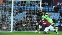 Manchester City's Raheem Sterling, right, scores past Aston Villa goalkeeper Brad Guzan and Jores Okore during the English FA Cup fourth round soccer match between Aston Villa and Manchester City at Villa Park in Birmingham, England, Saturday, Jan. 30, 2016. (Rui Vieira/AP)