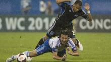 Montreal Impact's Daniele Paponi is brought down by San Jose Earthquakes' Jason Hernandez during first half CONCACAF champions league soccer action in Montreal, Wednesday, August 7, 2013. (Graham Hughes/THE CANADIAN PRESS)