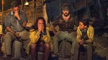 In this image released by CBS, contestants, from left, Jeff Varner, Sarah Lacina, Zeke Smith and Debbie Wanner appear at the Tribal Council portion of the competition series Survivor: Game Changers. (Jeffrey Neira/AP)