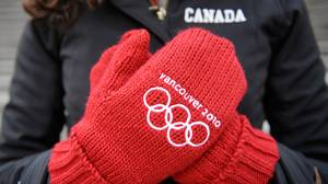 Globe reporter Amy Verner models a pair of HBC red Olympic mitts in Vancouver, B.C. Feb. 4, 2010.