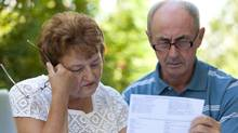 A senior couple goes over bills in this file photo (Pawel Gaul/iStockphoto)