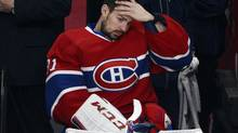 Montreal Canadiens goalie Carey Price watches from the bench during third period after being injured earlier in Game 1 (Ryan Remiorz/THE CANADIAN PRESS)