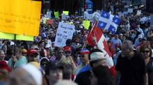 Demonstrators march against Quebec's proposed Charter of Values in Montreal on Sept. 29, 2013. (CHRISTINNE MUSCHI FOR THE GLOBE AND MAIL)