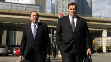 NHL Commissioner Gary Bettman (L) and Murray Edwards, co-owner of the Calgary Flames photographed while walking in Toronto, October 18, 2012. (Fernando Morales/The Globe and Mail)