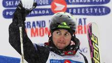 Canada's Alexandre Bilodeau celebrates his first place finish in the men's dual moguls at the World Cup freestyle ski competition at Mont Gabriel in Sainte-Adele, Quebec, January 15, 2011. (SHAUN BEST/REUTERS)