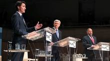 Liberal Leader Justin Trudeau, left, Conservative Leader Stephen Harper and New Democratic Party Leader Thomas Mulcair participate in the Munk Debate on Canada's foreign policy in Toronto, on Tuesday, Sept. 28, 2015. (MARK BLINCH/REUTERS)