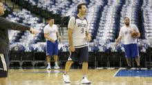 Former Dallas Cowboys quarterback Tony Romo walks the floor after a Dallas Mavericks morning NBA basketball shoot around in Dallas, Tuesday, April 11, 2017. (LM Otero/AP)