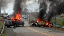 Vehicles burn in eastern New Brunswick on Thursday Oct. 17 after violence erupted near a reserve north of Moncton, N.B. RCMP had earlier moved in on an anti-fracking protest (Gilles Boudreau/CBC)