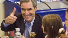 Liberal Leader Michael Ignatieff eats ice cream with a group of students during a visit to the Scotsburn Dairy operation in Truro, N.S. on Thursday, October 22, 2009. (ANDREW VAUGHAN)