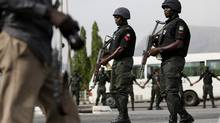 Police officers patrol the city of Abuja, Nigeria last month during a protest by the Bring Back Our Girls group, calling for the release of schoolgirls who were kidnapped by Islamist militant group Boko Haram (Afolabi Sotunde/Reuters)