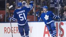 Toronto Maple Leafs' William Nylander, right, celebrates with teammate Jake Gardiner after scoring his team's fourth goal. (Chris Young/THE CANADIAN PRESS)