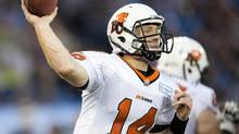 B.C. Lions quarterback Travis Lulay launches a pass against the Toronto Argonauts during first half CFL action in Toronto on Tuesday July 30, 2013. (FRANK GUNN/THE CANADIAN PRESS)