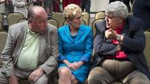 Ontario Premier Kathleen Wynne is flanked by Northwest Territories Premier Bob McLeod, left, and Alberta Premier Dave Hancock at a news conference after a meeting of premiers and aboriginal leaders in Charlottetown on Wednesday, August 27, 2014.