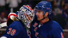 Wade Redden, right, seen during a Rangers game this season, has a contract that has many observers wondering what Glen Sather was thinking when he signed the free-agent defenceman last summer. (Jim McIsaac/2008 Getty Images)