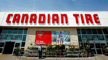 Customers head in and out of a Canadian Tire store location in Scarborough, Ont. (Deborah Baic/Deborah Baic/THE GLOBE AND MAIL)