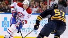Buffalo Sabres defenceman Tyler Myers backs up as Montreal Canadiens left winger Andrei Kostitsyn moves the puck in Buffalo, Feb. 17, 2012. (Doug Benz/Reuters/Doug Benz/Reuters)