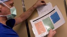 A surgical checklist is examined at Toronto General Hospital in January, 2009. (Peter Power/The Globe and Mail)