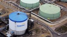 Petroleum storage tanks at the Suncor tar sands operations near Fort McMurray, Alberta. (TODD KOROL/REUTERS)
