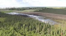 An aerial view of the spill of emulsion, a mixture of bitumen, water and sand, lies on the surface on a feeder pipeline corridor near the Nexen Energy's Long Lake oilsands facility south of Fort McMurray, Alberta on July 17, 2015. (HANDOUT/REUTERS)