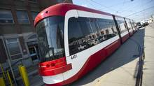 Toronto's new streetcars were on display at the TTC's Hillcrest complex in Toronto , Ontario Tuesday, July 23, 2013. The new streetcars will accommodate 70 passengers seated and 181 standing and will feature low-floor access for easier entry, a deployable wheel-chair ramp when required and an area for bicycles. (Kevin Van Paassen/The Globe and Mail)