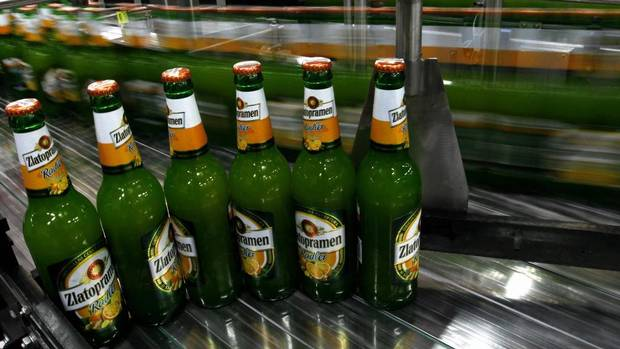 "Bottles filled with Zlatopramen radler beer travel along a conveyor belt in Krusovice Brewery, about 64 kilometres west of Prague, Czech Republic. So-called ""radlers"" are beers mixed with drinks such as Sprite, lemonade or fruit-flavoured beverages. (PETR JOSEK/REUTERS)"