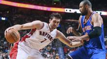 Toronto Raptors' Andrea Bargnani (7) drives to the net past New York Knicks' Tyson Chandler in the first half of their preseason NBA game in Montreal, October 19, 2012. (CHRISTINNE MUSCHI/REUTERS)