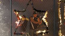 Fans of Bolivia's San Jose FC light fireworks before their Copa Libertadores qualifying soccer match against Brazil's Corinthians in Oruro February 20, 2013. (DAVID MERCADO/REUTERS)