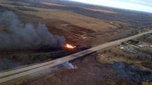 CN spokesman Louis-Antonie Paquin says three of the nine propane tankers remain on fire, at least 12 hours after the early morning derailment near Gainford, Alta., on Oct. 19, 2013. (HANDOUT/Parkland County/Facebook)