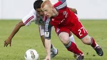 Toronto FC's Richard Eckersley, right, and Real Esteli FC's Manuel Rosas battle for the ball during the first half of a CONCACAF Champions League soccer match in Toronto (Darren Calabrese/The Canadian Press)