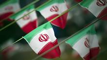 Iranian flags are shown in Tehran. Iran confirmed on July 25, 2014, that it has detained four journalists, including a reporter for The Washington Post and two freelance photographers, but did not disclose details about why they were being held. (MORTEZA NIKOUBAZL/REUTERS)