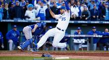 Kansas City Royals' Eric Hosmer scores a run during a seventh-inning rally against the Toronto Blue Jays during Game 2 of the American League Championship Series at Kauffman Stadium on Oct. 17. (Jamie Squire/Getty Images)